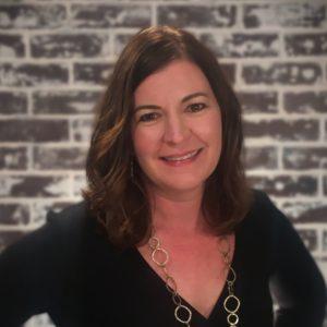 Headshot photo of Kari Sutherland.